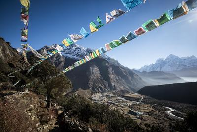 https://imgc.artprintimages.com/img/print/prayer-flags-flutter-in-the-wind-above-thame-a-remote-village-in-the-everest-region-of-nepal_u-l-poli660.jpg?p=0