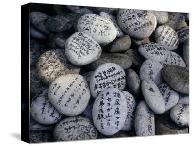 Prayer on Stones at the Feet of a Buddha (Senyu-Ji), Japan