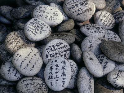 Prayer on Stones at the Feet of a Buddha (Senyu-Ji), Japan Photographic  Print by | Art com