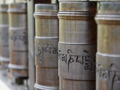 https://imgc.artprintimages.com/img/print/prayer-wheels-in-dhagpo-kagyu-ling-tibetan-buddhist-monastery-saint-leon-sur-vezere-dordogne_u-l-p8zncn0.jpg?p=0