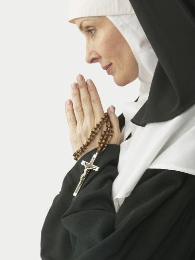 Praying Nun Holding Rosary--Photographic Print