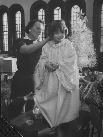 https://imgc.artprintimages.com/img/print/preparations-for-christmas-pageant-at-bryn-mawr-community-church-and-at-orphanage_u-l-py6h1d0.jpg?p=0