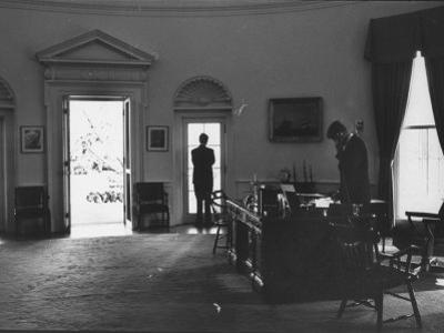 Pres. John F. Kennedy and Attorney Gen. Robert F. Kennedy Conferring in the Oval Office