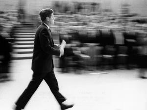 Pres John Kennedy Walking Fast after Press Conference in State Department Auditorium, Mar 11, 1963