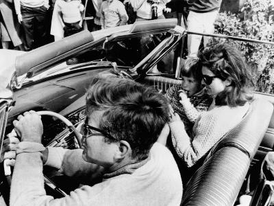 Pres Kennedy Drives an Open Car in Newport, Rhode Island--Photo