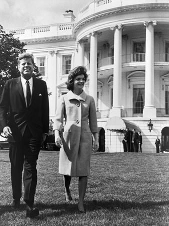 President and Mrs. John F. Kennedy Walking on the South Lawn of the White House on April 16, 1962--Photo