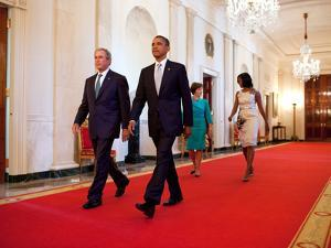President Barack Obama and First Lady Michelle Obama Walk with Former President George W Bush