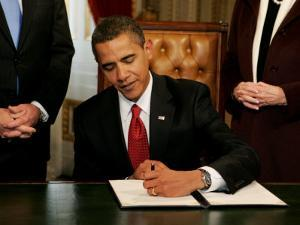 President Barack Obama Signs His First Act as President in the President's Room, January 20, 2009