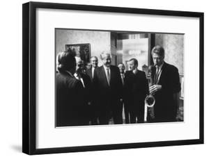 President Bill Clinton Plays the Saxophone Presented to Him by Russian President Boris Yeltsin