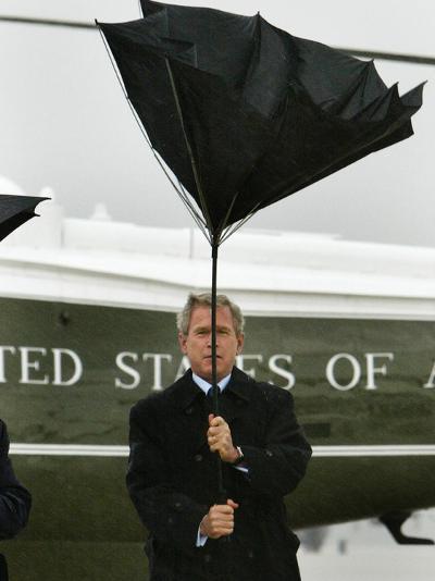 President Bush Jokingly Holds His Wind-Blown Umbrella Upright--Photographic Print