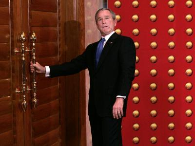 President George W. Bush as He Tries to Open a Locked Door Leaving a Press Conference in Beijing--Photographic Print