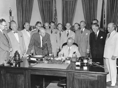 President Harry Truman Signing H.R. 5632, the National Security Act Amendments of 1949