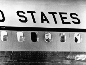 President John Kennedy Peers Out from Window of Air Force One