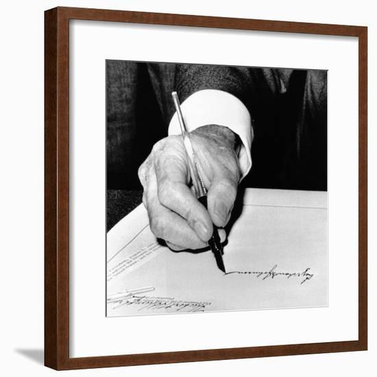President Lyndon Johnson Signing the 1965 Civil Rights Bill, also known as the Voting Rights Act--Framed Photo