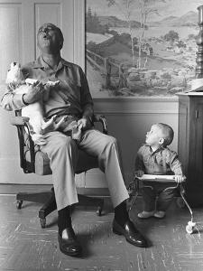 President Lyndon Johnson Sings with Dog Yuki While His Grandson Looks On, 1968