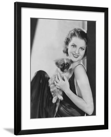 Pretty Woman with Her Pekingese Puppy--Framed Photo