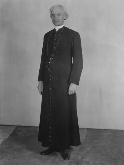 Priest in Cassock--Photo