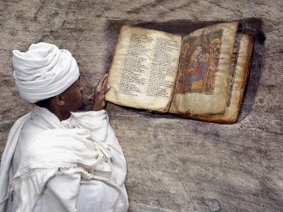Priest of Ethiopian Orthodox Church Reads Old Bible at Rock-Hewn Church of Yohannes Maequddi-Nigel Pavitt-Photographic Print