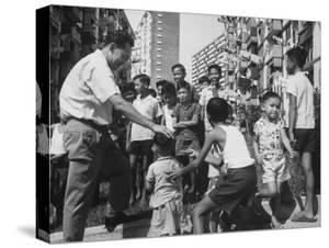 Prime Minister Kuan Yew Lee Talking to Children While Visiting a Housing Project