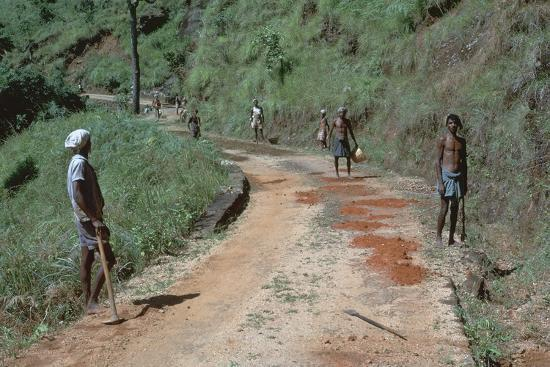 Primitive road-repairs in Sri Lanka. Artist: CM Dixon Artist: Unknown-CM Dixon-Photographic Print