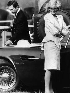 Prince Charles Examining the Bodywork of His Aston Martin