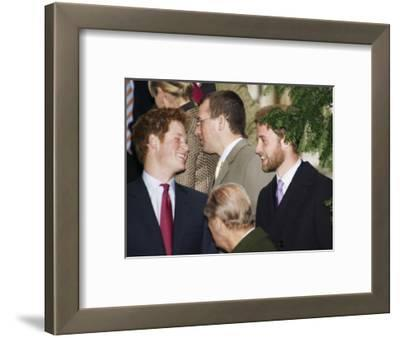 Prince William sporting a new beard with his brother Prince Harry as the Royal Family attend a Chri