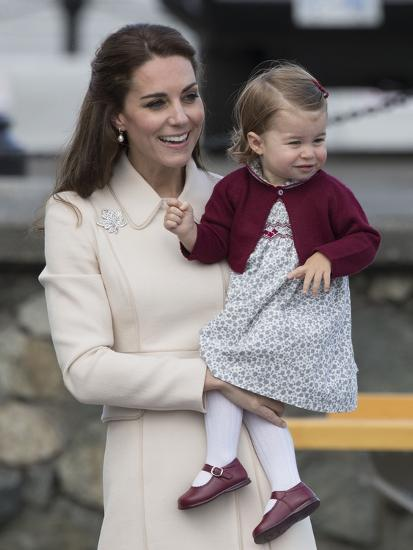 Princess Charlotte held by her mother Kate-Associated Newspapers-Photo