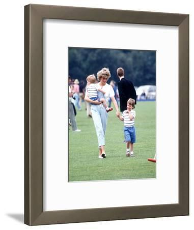 Princess of Wales with Prince Harry and Prince William at a polo match at Windsor