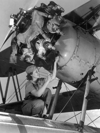 20-year-old-women-and-expert-aviation-mechanic-working-on-a-wright-whirlwind-airplane-motor