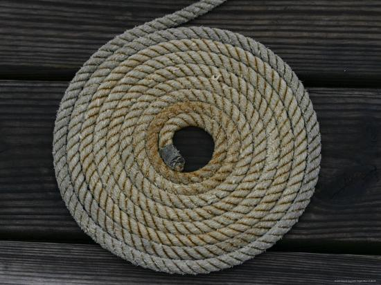 a-boat-rope-coiled-in-a-pattern-to-avoid-tangling