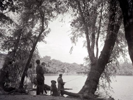 a-family-out-in-the-countryside-fishing-on-the-bank-of-a-lake-1953