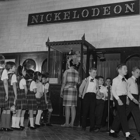 a-group-of-school-children-at-the-nickelodeon-theater-box-office