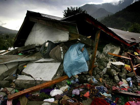 a-pakistani-earthquake-survivor-takes-shelter-from-the-rain