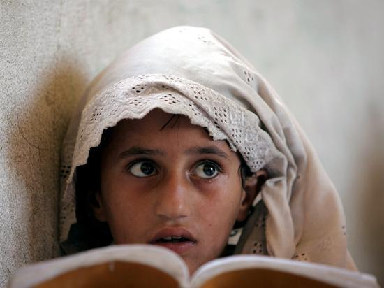 a-small-girl-takes-lessons-at-the-nangalam-high-school-in-nangalam-eastern-afghanistan