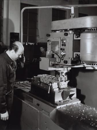 a-villani-ferrari-factory-worker-operating-a-machine