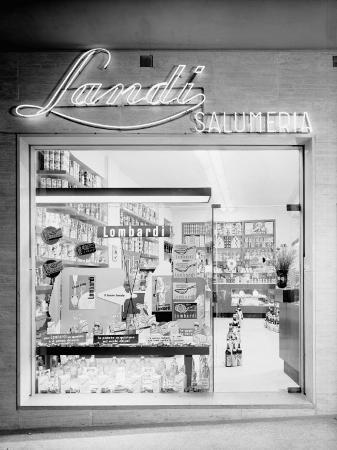 a-villani-window-of-the-landi-delicatessen-showing-products-from-the-lombardi-company