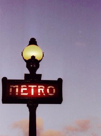 abdul-kadir-audah-metro-stop-in-paris-against-sunset-sky
