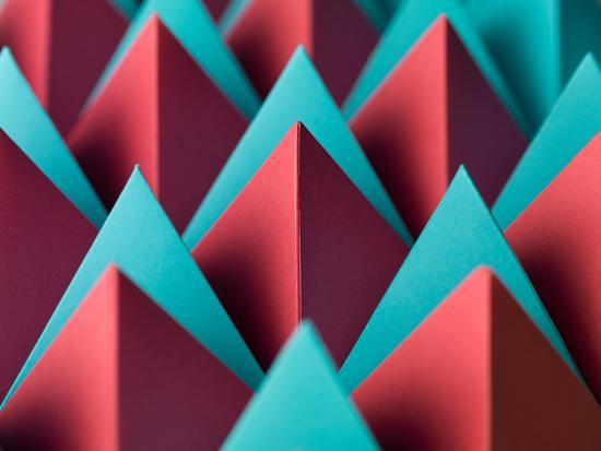 abstract-oil-work-abstract-geometrical-background-with-colorful-paper-pyramids-selective-focus