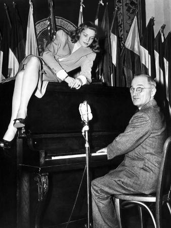 actress-lauren-bacall-sits-atop-the-piano-while-vice-president-harry-truman-plays