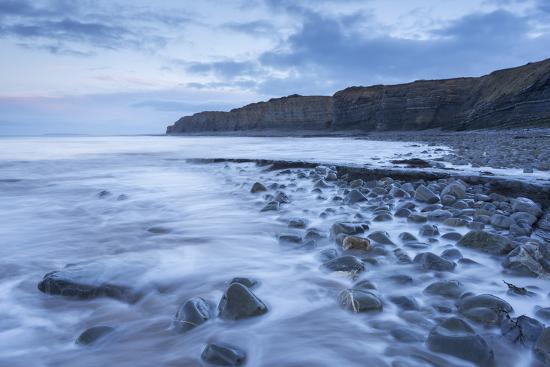 adam-burton-incoming-tide-at-kilve-beach-in-somerset-england-winter-january