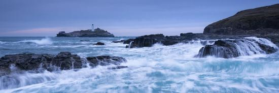 adam-burton-waves-crash-around-the-rocks-near-godrevy-lighthouse-cornwall-england-winter-february