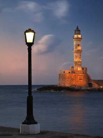 adam-jones-lighthouse-and-lighted-lamp-post-at-dusk-chania-crete-greece