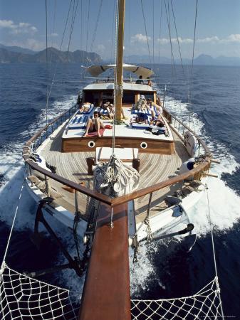adam-woolfitt-tourists-sunbathing-on-deck-of-gulet-turkey-eurasia