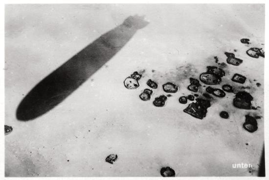 aerial-view-of-a-desert-settlement-with-a-shadow-cast-by-a-zeppelin-1931
