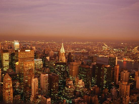 aerial-view-of-new-york-city-at-night-with-illuminating-lights-from-buildings-and-skyscrapers