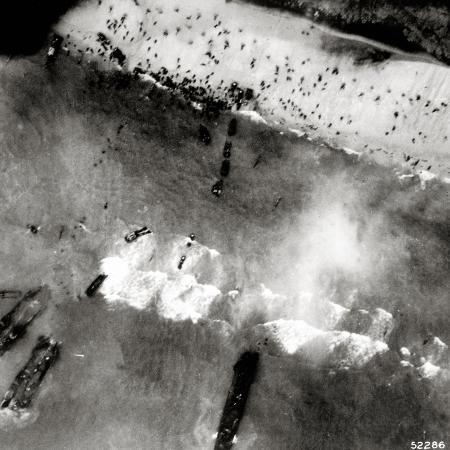 aerial-view-of-the-first-landing-with-landing-craft-and-allied-soldiers