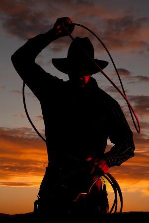 alan-and-vicena-poulson-cowboy-in-sunset-with-rope