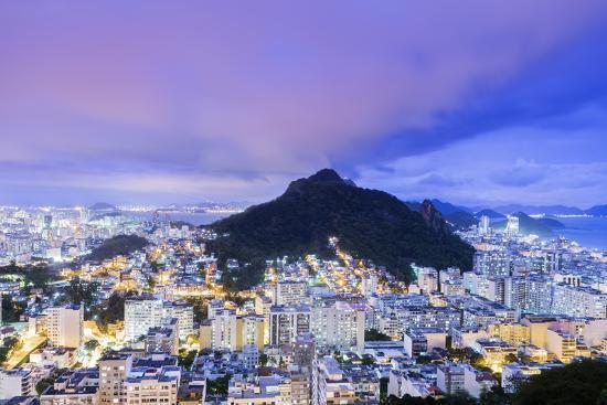 alex-robinson-twilight-illuminated-view-of-copacabana-the-morro-de-sao-joao