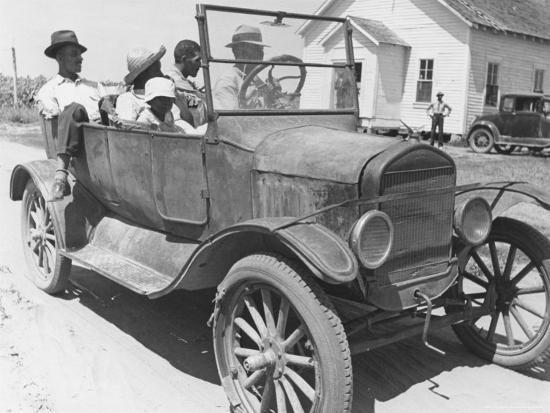 alfred-eisenstaedt-african-american-men-and-a-boy-in-dusty-jalopy-in-front-of-clapboard-church