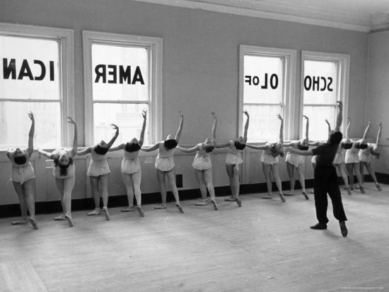 alfred-eisenstaedt-dancers-at-george-balanchine-s-school-of-american-ballet-lined-up-at-barre-during-training